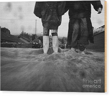 Children Walking In Heavy Rain Storm In The Street Wood Print by Joe Fox