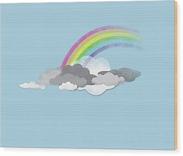 Clouds And A Rainbow Wood Print by Jutta Kuss