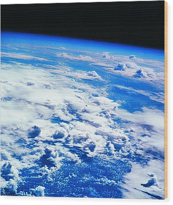 Clouds Over Earth Viewed From A Satellite Wood Print by Stockbyte