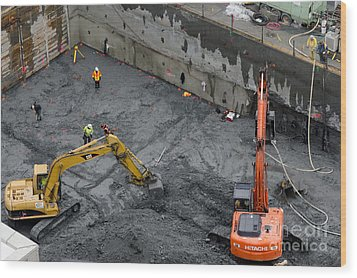 Construction Site Diggers And Workmen In The Foundation Pit Of A New Building Seattle Wood Print by Andy Smy