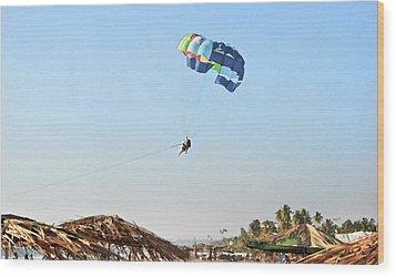 Couple Parasailing Over Shacks Goa Wood Print by Kantilal Patel