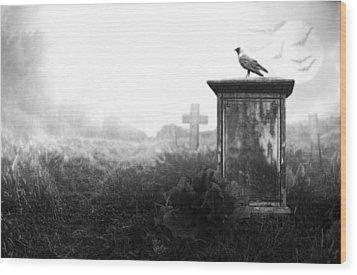 Crow On A Gravestone Wood Print by Jaroslaw Grudzinski