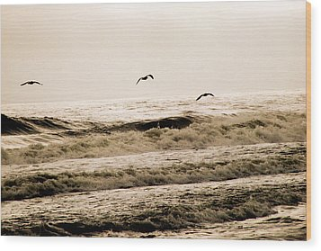 Dodging The Waves Wood Print by Trish Tritz