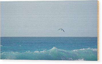 Eagle Flying Over Sea Wood Print by Fabian Jurado's Photography.