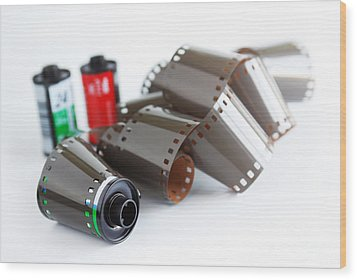 Film And Canisters Wood Print by Carlos Caetano
