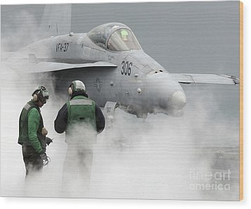 Flight Deck Personnel Are Surrounded Wood Print by Stocktrek Images