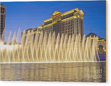 Fountains Of Bellagio In Front Of Caesar's Palace Hotel And Casi Wood Print by Andre Babiak