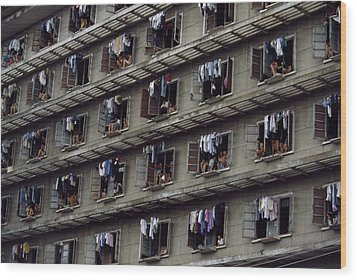 Laundry Drying Outside Apartments Wood Print by Paul Chesley