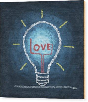 Love Word In Light Bulb Wood Print by Setsiri Silapasuwanchai