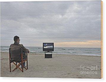 Man Watching Tv On Beach At Sunset Wood Print by Sami Sarkis