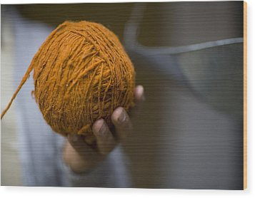 Mans Hand Holds Ball Of Orange Wool Wood Print by David Evans