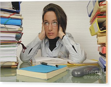 Mature Office Worker Sitting At Desk With Piles Of Folders Wood Print by Sami Sarkis