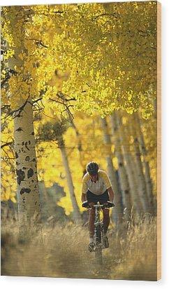 Mountain Biking Through A Grove Wood Print by Bill Hatcher