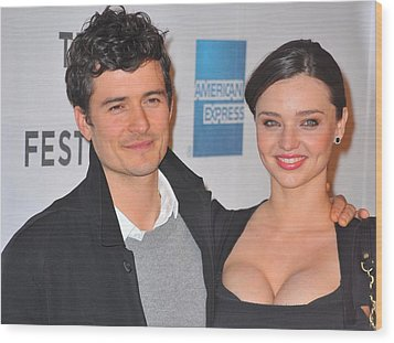 Orlando Bloom, Miranda Kerr At Arrivals Wood Print by Everett