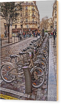 Paris Wheels For Rent Wood Print by Bob and Nancy Kendrick