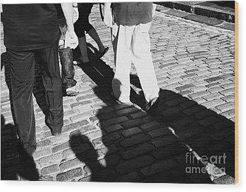 People Walking Along The Cobbled Streets Of Castle Hill Edinburgh Scotland Uk United Kingdom Wood Print by Joe Fox