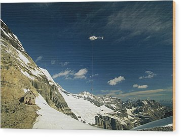 Person Dangles From A Helicopter Wood Print by Michael Melford