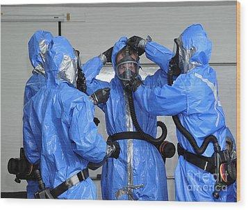 Personnel Dressed In Hazmat Suits Wood Print by Stocktrek Images