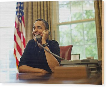 President Barack Obama Talks By Phone Wood Print by Everett