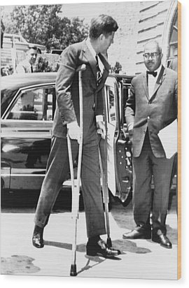 President John F. Kennedy On Crutches Wood Print by Everett