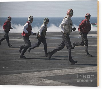 Sailors Clear The Landing Area Wood Print by Stocktrek Images