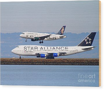 Star Alliance Airlines And Frontier Airlines Jet Airplanes At San Francisco International Airport Wood Print by Wingsdomain Art and Photography