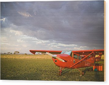 The Cessna Makes A Pit Stop To Refuel Wood Print by Michael Fay
