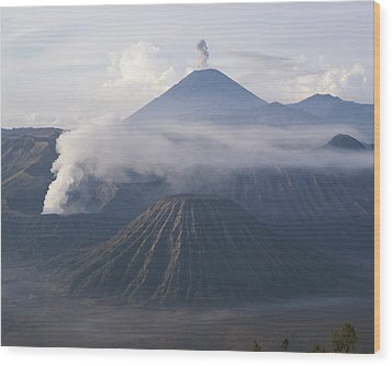 The Peak Of Semaru Rises Above Mount Wood Print by Carsten Peter