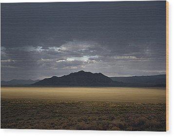 The Setting Sun Permeates Rain Clouds Wood Print by James P. Blair