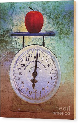 The Weight Of An Apple Wood Print by Tara Turner
