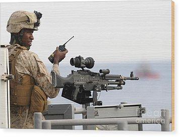 U.s. Marine Talks On A Radio While Wood Print by Stocktrek Images