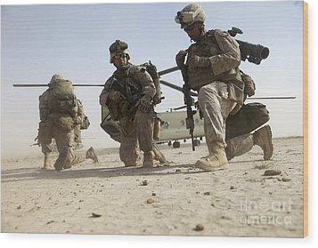 U.s. Marines Unloading Wood Print by Stocktrek Images