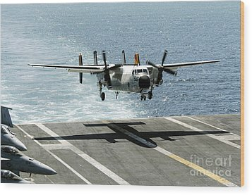 A C-2a Greyhound Prepares To Land Wood Print by Stocktrek Images