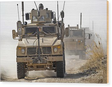 A U.s. Army M-atv Leads A Convoy Wood Print by Stocktrek Images