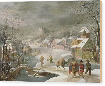 A Winter Landscape With Travellers On A Path Wood Print by Denys van Alsloot