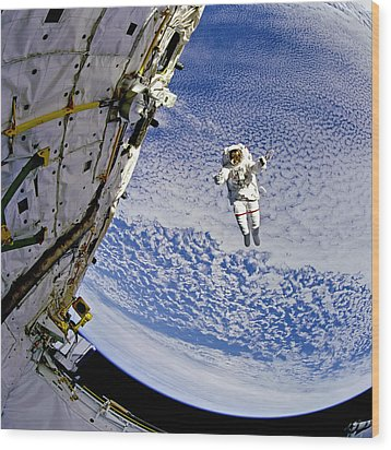 Astronaut In Atmosphere Wood Print by The  Vault - Jennifer Rondinelli Reilly