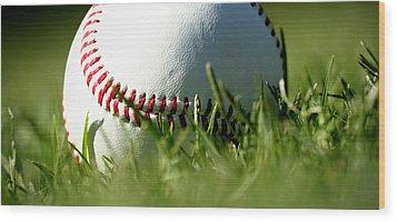 Baseball In Grass Wood Print by Chris Brannen