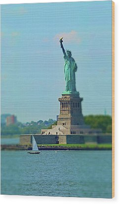 Big Statue, Little Boat Wood Print by Sandy Taylor