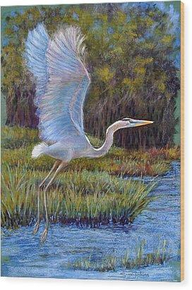 Blue Heron In Flight Wood Print by Susan Jenkins