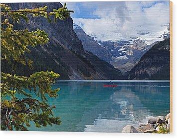 Canoe On Lake Louise Wood Print by Larry Ricker