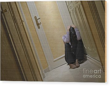 Depressed Woman Sitting In Corridor With Head In Hands Wood Print by Sami Sarkis
