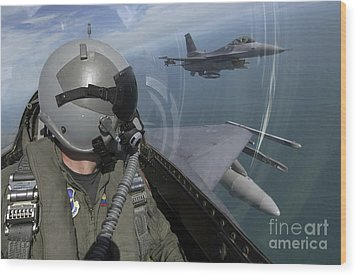F-16 Fighting Falcons Flying Wood Print by Stocktrek Images