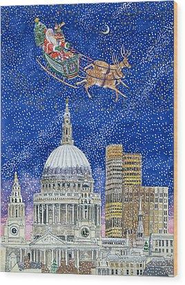 Father Christmas Flying Over London Wood Print by Catherine Bradbury