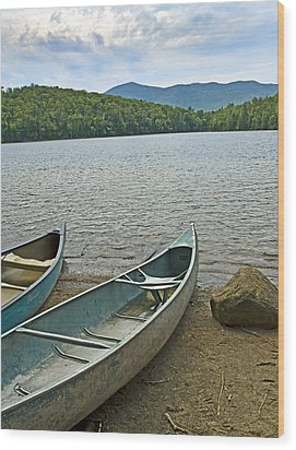 Heart Lake Canoes In Adirondack Park New York Wood Print by Brendan Reals
