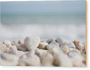 Heart Shaped Pebble On The Beach Wood Print by Alexandre Fundone