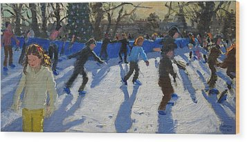 Ice Skaters At Christmas Fayre In Hyde Park  London Wood Print by Andrew Macara