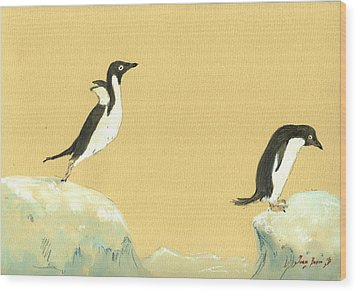 Jumping Penguins Wood Print by Juan  Bosco