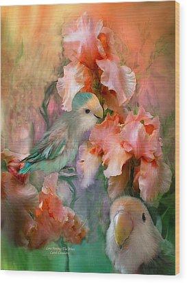 Love Among The Irises Wood Print by Carol Cavalaris