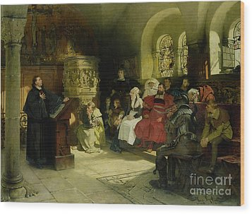 Luther Preaches Using His Bible Translation While Imprisoned At Wartburg Wood Print by Hugo Vogel