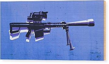 M82 Sniper Rifle On Blue Wood Print by Michael Tompsett
